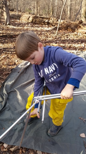 Learning to set up the tent